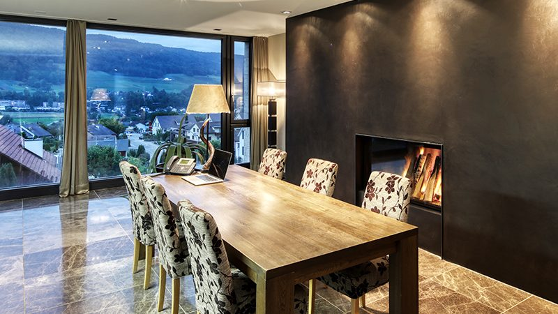 Dining room with a modern fireplace