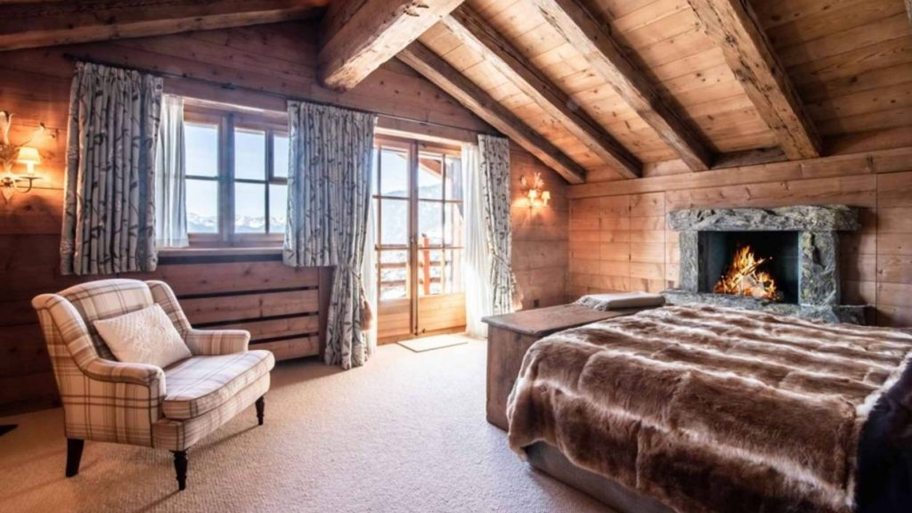 Wooden bedroom with fireplace