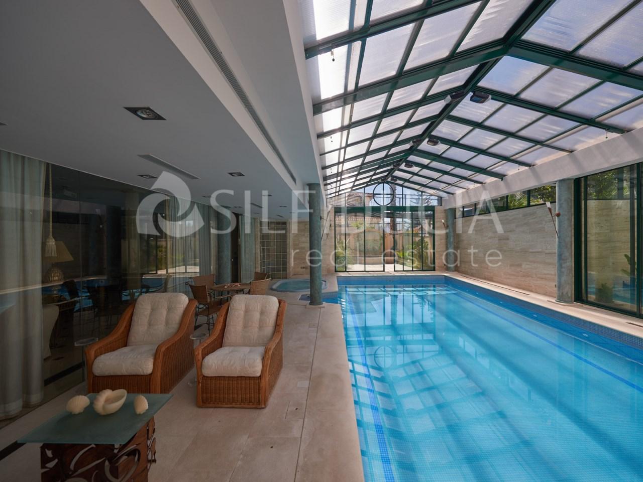 Indoor pool of an elegant villa for sale in Lisbon