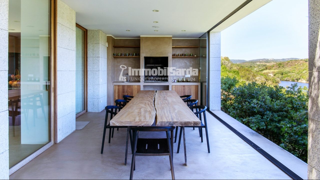 Covered dining area with direct sea views