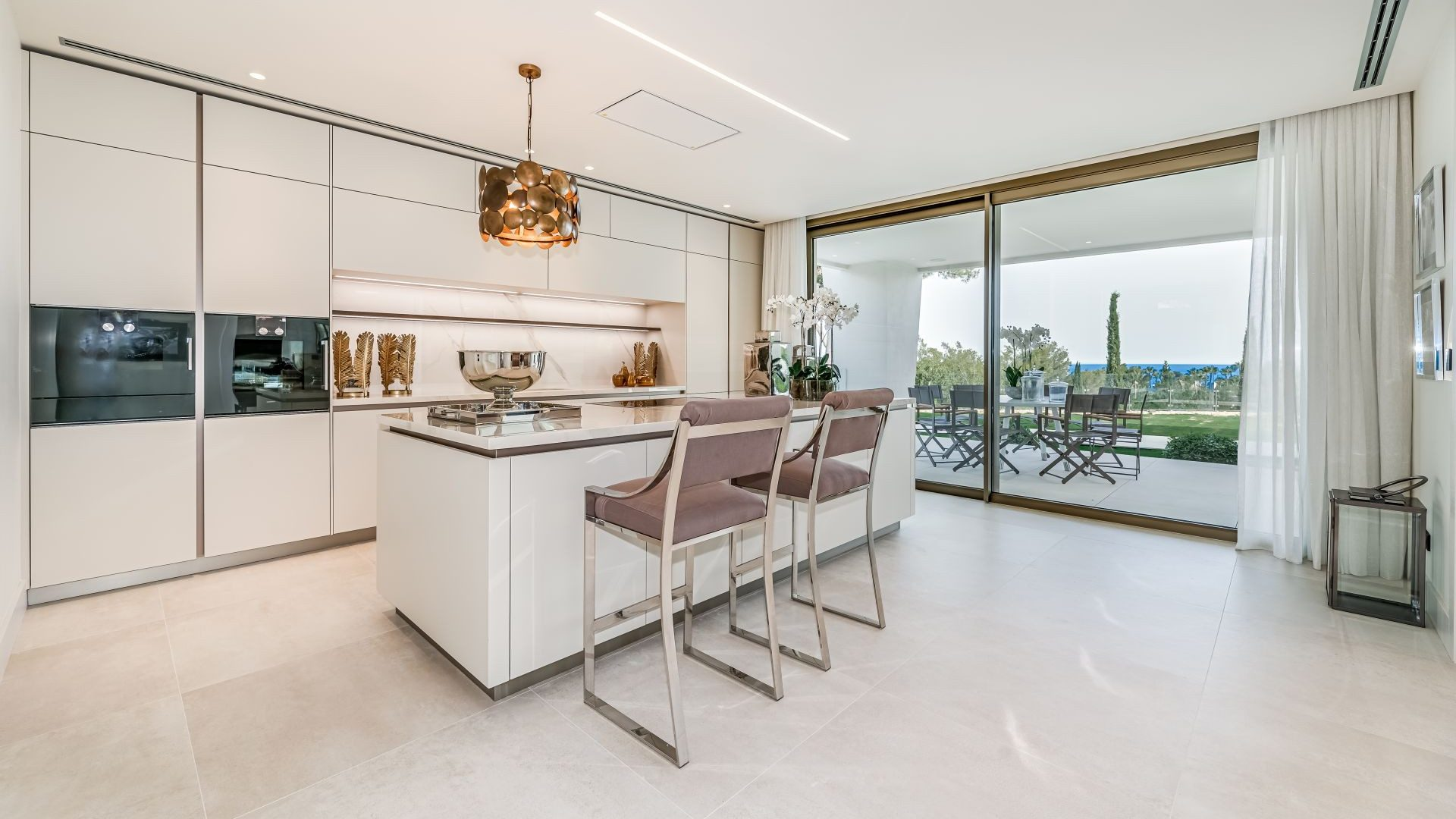Kitchen with central island and direct terrace access