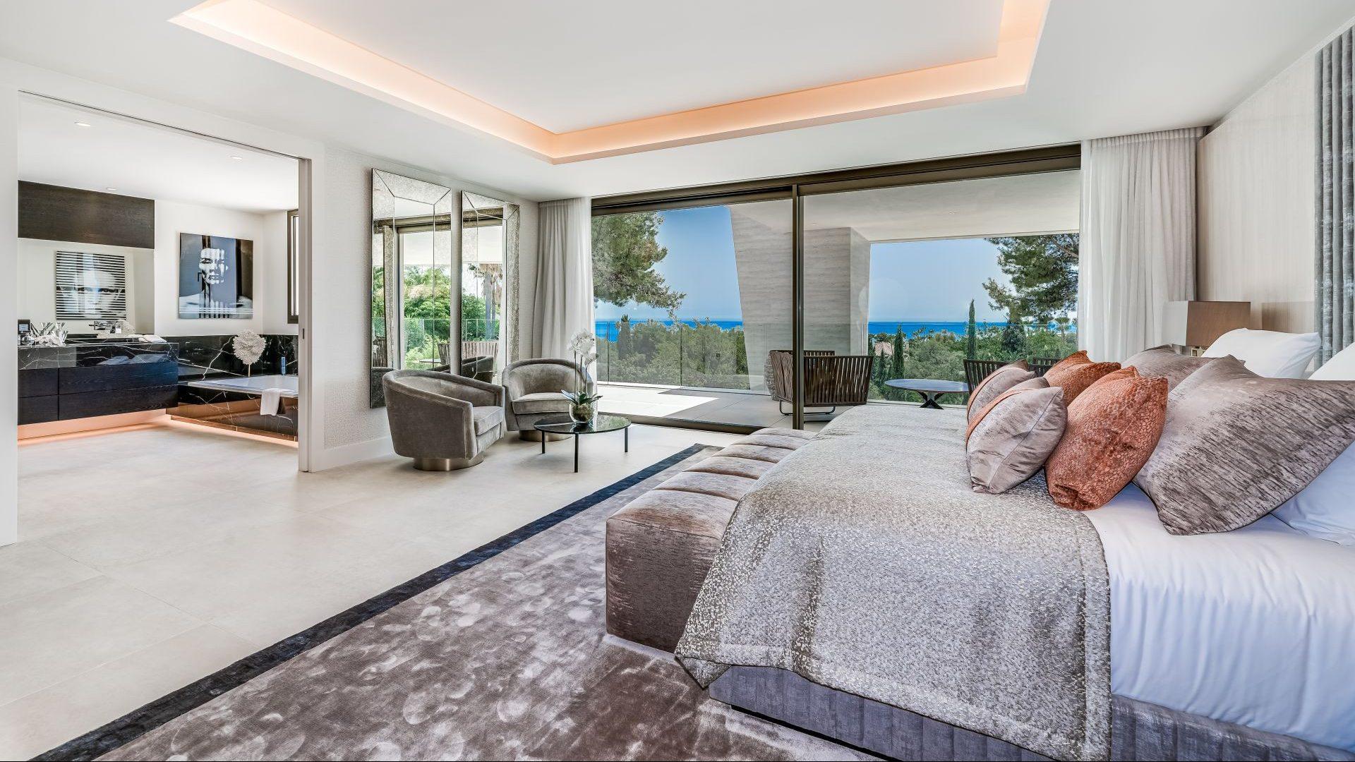 Main bedroom with open plan en-suite bathroom and views of the sea